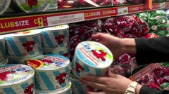 Woman selecting The Laughing Cow and Babybel cheese in grocery store Stock Footage