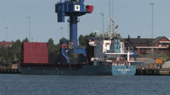 Ships unload their cargo in a Swedish port - stock footage