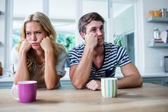 Annoyed couple ignoring each other - stock photo