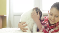 Little girl and puppy Shepherd Stock Footage