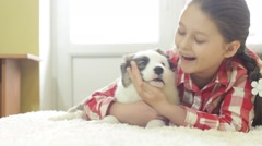 Pretty girl hugging a puppy Shepherd Stock Footage