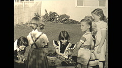 Vintage 16mm film, 1945 USA, children birthday party, wonderfully charming - stock footage