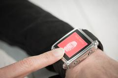 Composite image of businesswoman using a smart watch Stock Photos