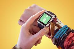 Composite image of hand using smart watch Stock Photos