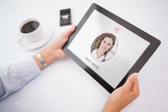 Composite image of man using tablet pc - stock photo
