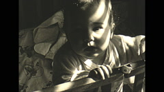 Vintage 16mm film, 1945 USA, toddler in playpen, very happy Stock Footage
