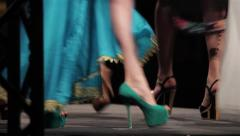 Mannequin legs seen at a fashion parade on a stage located in the center Stock Footage