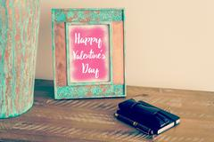 Photo frame with message HAPPY VALENTINE'S DAY Stock Photos