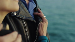 Close up middle-aged couple enjoying the sunset over the ocean - stock footage