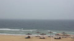 rain on the beach deserted beach waves of the sea storm - stock footage