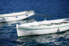 Small wooden boats moored in mediterranean sea marina. - stock photo