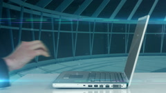 Hand using laptop with blue interface Stock Footage