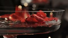 Red rose petals, water and candles - stock footage
