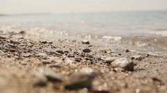 Stones on the beach in the day Stock Footage