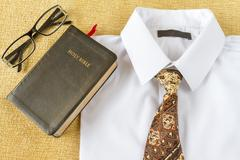 Business man style clothes and Holy Bible at home Stock Photos
