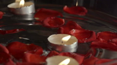 Red rose petals, water and candles Stock Footage