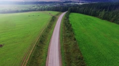 Aerial view of unlimited space of forest plain and cars which are riding on - stock footage