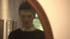 Girl looks in the mirror Stock Footage
