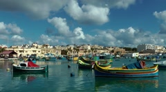 Marsaxlokk, Malta, fishing village on a sunny day Stock Footage