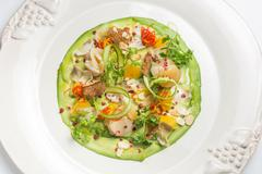 Carpaccio of prawns with citrus sauce on a white background. Gourmet cuisine. - stock photo