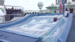 Cruise ship recreation teenager learn to surf pool HD 061 Stock Footage