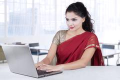 Indian entrepreneur working with traditional clothes Stock Photos