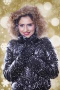 Lovely indian woman wearing winter jacket - stock photo