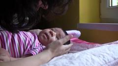 Mom keeps her daughter in her arms, a tickle and kiss - stock footage