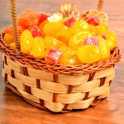 Dried fruits and candied fruit in the basket - stock photo