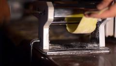 Housewife uses noodle making machine for making noodles. The dough for noodle  Stock Footage