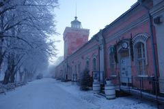 EDITORIAL: Jetty barracks and clock tower on winter morning in Suomenlinna. Stock Photos