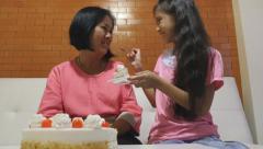 Asian Senior woman celebrating birthday with family Stock Footage