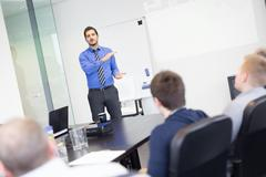 Business man making a presentation in office on job interview. Stock Photos