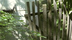 Person opens an old wooden gate for entering the garden, then closes it behind 1 Stock Footage