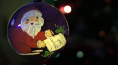 Multicolored Christmas lights on a black background. Besides, a globe with 10 Stock Footage