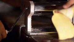 Housewife uses noodle making machine for making noodles. The dough for noodle  - stock footage
