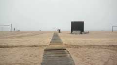 Wooden plank path to beach ocean horizon, foggy mist, Portimao, Portugal Stock Footage