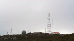 Radar dome, radio communication antenna tower on top of mountain Stock Footage