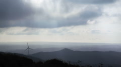 Windmill generator in mountains, heavenly sun rays, horizon view, Portugal Stock Footage