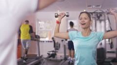 4K Woman working out with personal trainer at the gym Stock Footage