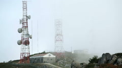 Fog mist cloud, radio communication towers, Monchique mountains, Portugal Stock Footage