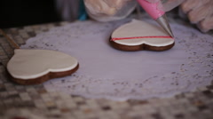 a confectioner decorates cookies for Valentine's Day - stock footage
