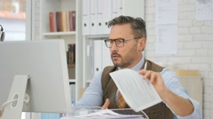 Middle-aged businessman working on desktop - stock footage