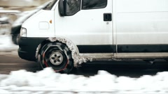 Van with snow chains on frozen road Stock Footage