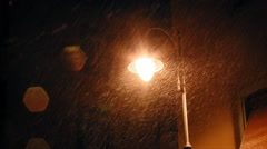 Lamppost under the snowfall Stock Footage