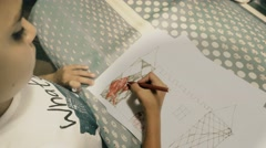 Little girl coloring castles - stock footage