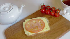 Making sandwich with tomato, ham, cheese Stock Footage