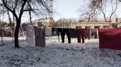 Several Pairs of Clothes Drying Near The House in Winter Stock Footage