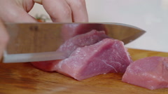 Male hands cutting fresh meat Stock Footage