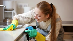 Portrait of positive housewife cleaning with supplies in kitchen Stock Footage
